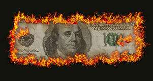 Burning old hundred banknote. On black bacground Royalty Free Stock Photography