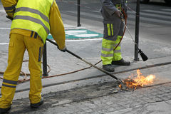 Burning old paint. Worker burning old paint - Paris, France Royalty Free Stock Photography