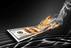 Burning one hundred dollars banknote. On abstract black background Stock Image