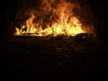 Burning oven with flames Royalty Free Stock Photos