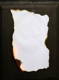 Burning paper. Paper burning on black background Royalty Free Stock Image