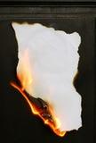 Burning paper. Paper burning on black background Stock Photo