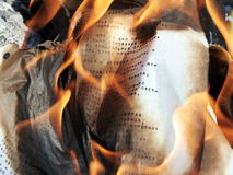 Burning paper. With typed russian letters Stock Photo