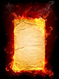 Burning paper. On black background Royalty Free Stock Photos