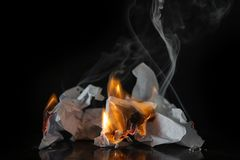Burning paper on a black background. Ash, fire stock photography