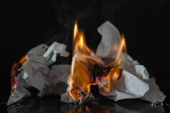 Burning paper on a black background. Fire and ashes from writing, memories royalty free stock image