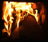 Burning paper and cardboard - orange and yellow glowing flames.  Stock Images