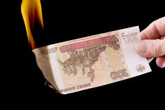 Burning paper currency macro Stock Photos