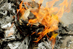 Burning paper gold Ghost for Chinese Ghost Royalty Free Stock Photo