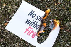 Burning paper on the ground Stock Photos