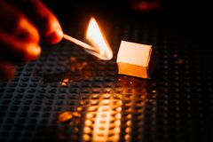 Burning paper house. Witch match in the handn royalty free stock photography