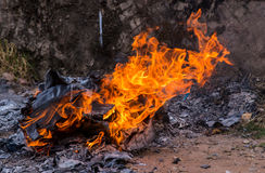 burning papers and box with flames and ash Royalty Free Stock Images