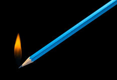 Burning pencil Stock Images
