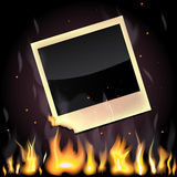 Burning photo card. Illustration of empty photo card, burning in the flame Stock Images