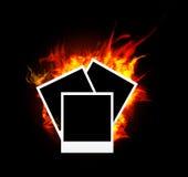 Burning photo frame. With orange flame Stock Photos