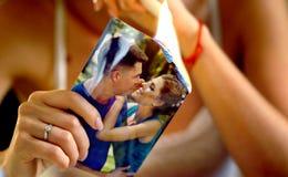 Burning photography kissing newlywed. Couple break up. stock photography