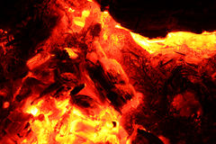 Burning pieces of charcoal  background Royalty Free Stock Photography