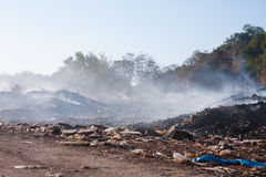 Burning pile of garbage. Royalty Free Stock Image
