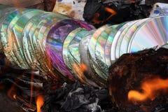 burning piratkopiering arkivfoto