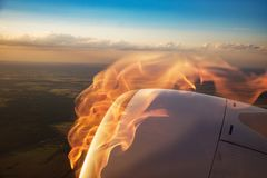 Burning plane engine, fire and smoke, view from the window royalty free stock photography