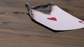 Burning poker card ace of hearts. Burning ace of hearts card stock footage