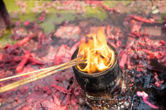 Burning prayer incense at a Buddhist temple Stock Photography