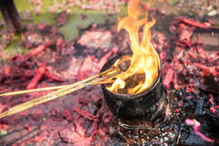 Burning prayer incense at a Buddhist temple. Stock Photo