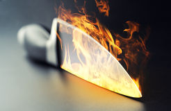 Burning professional kitchen knife Royalty Free Stock Photography