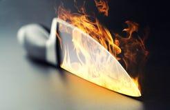 Burning professional kitchen knife. Closeup of burning professional kitchen knife royalty free stock photography