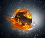 Burning puck with shards of ice on abstract background stock image