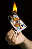 Burning the queen of spades. Royalty Free Stock Image