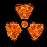 Burning radioactive symbol. At black background Royalty Free Stock Photography