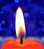 Burning red candle Stock Image