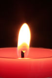 Burning red candle Stock Photos