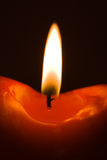 Burning red candle Royalty Free Stock Images