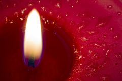 Burning red candle Royalty Free Stock Photo