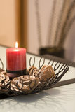 Burning red candle in glass holders Royalty Free Stock Image
