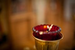 Burning red candle in the Orthodox Church royalty free stock photos