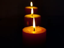 Burning red candles Stock Photo