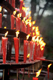 Burning red candles Royalty Free Stock Photos