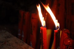 Burning red candles against a dark background Royalty Free Stock Image