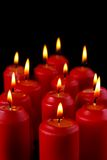 Burning red candles Stock Images