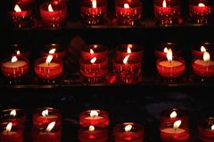 Burning red candles in a church Stock Image