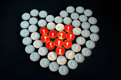 Burning red candles heart Stock Photo
