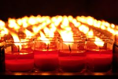 Burning red candles. Candles light background. Candle flame at night. stock image