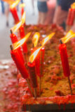 Burning red chinese candle in temple Royalty Free Stock Photography