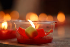 Burning red flower candle at chinese shrine for making merit in Royalty Free Stock Image