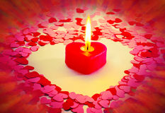 Burning red heart shaped candle Stock Photos