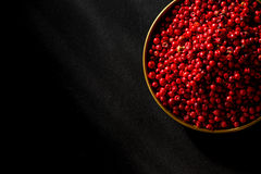 Burning red hot chili seed ob black background Stock Image