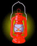 Burning red oil lamp. On a black background Royalty Free Stock Image